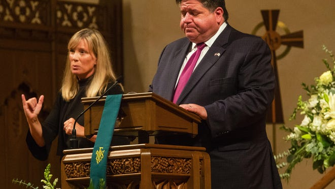 Illinois Gov. JB Pritzker speaks during a memorial service to honor those who have lost their lives to COVID-19 and their families at First Presbyterian Church in Springfield on Wednesday.