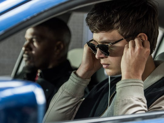 "Ansel Elgort (right, with Jamie Foxx) plays a getaway-car driver determined to leave his past behind in ""Baby Driver,"" written and directed by Edgar Wright."