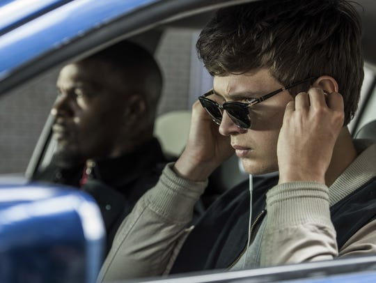 Ansel Elgort, right, and Jamie Foxx in a scene from