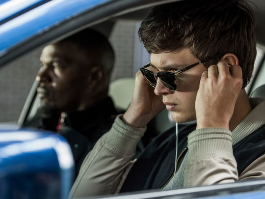 """This image released by Sony Pictures shows Ansel Elgort, right, and Jamie Foxx in a scene from """"Baby Driver,"""" in theaters on June 28. (Wilson Webb/Sony/TriStar Pictures via AP)"""