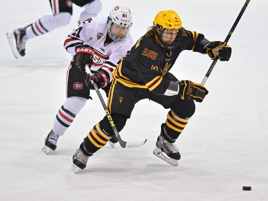 St. Cloud State's Jimmy Murray tries to get the puck