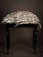 """Beth Lipman's """"Laid Table with Fish"""" (2011) includes"""