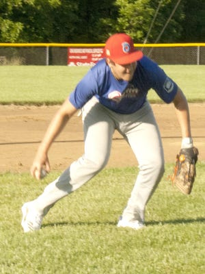 Ottawa American Legion's Cole Swanson, of Wellsville, fields a ground ball and sets to throw the ball to first base during Thursday's practice. The Arrows open the season 6 p.m. Tuesday at home against Emporia, the defending state champions. [PHOTO BY GREG MAST/THE OTTAWA HERALD].