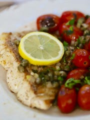 Pan-fried grouper cooks in a small amount of oil on
