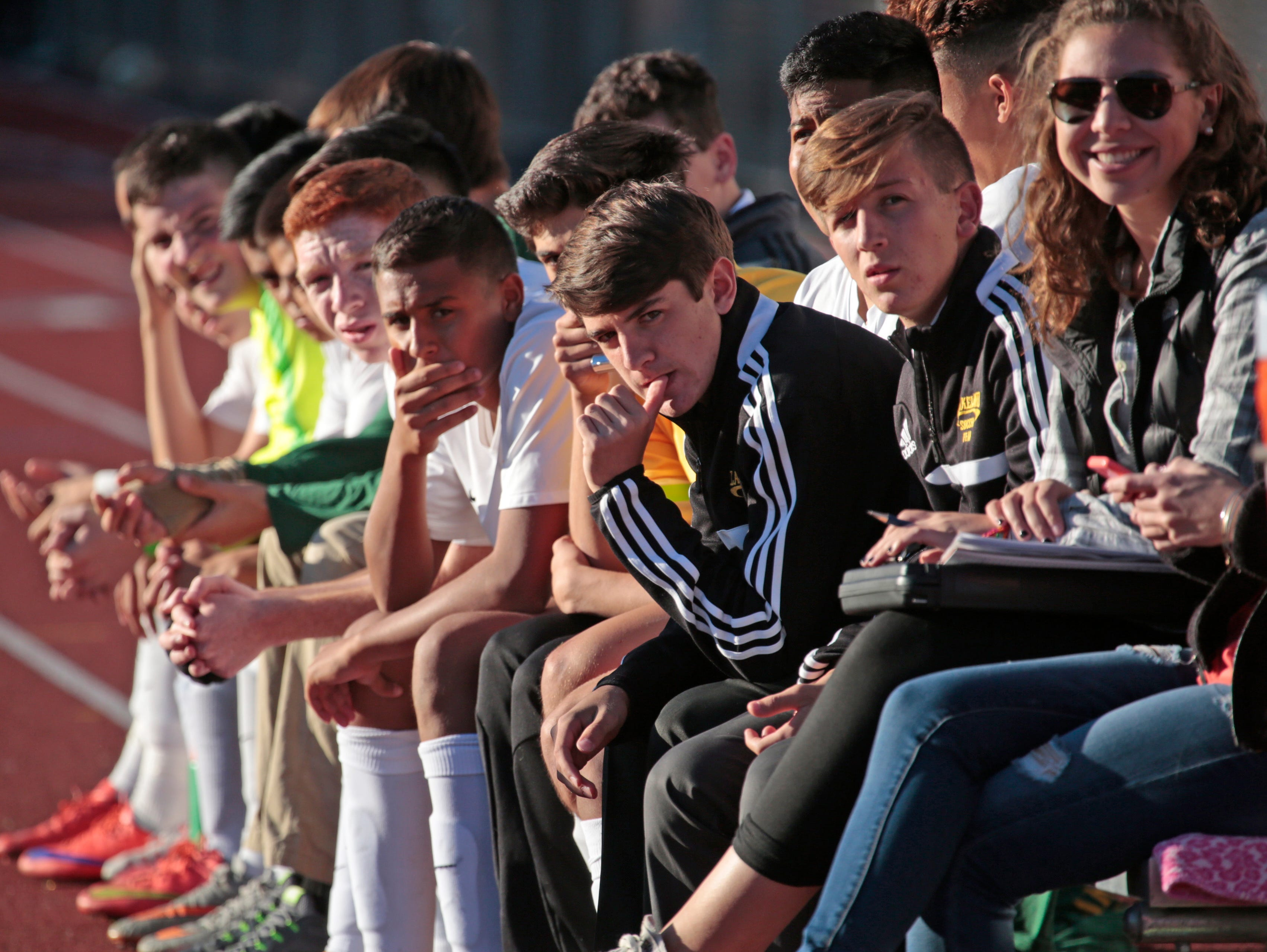 Members of Lakeland's soccer team watch the game from the bench against Eastcheser at Lakeland High School in Shrub Oak on Oct. 26, 2015.