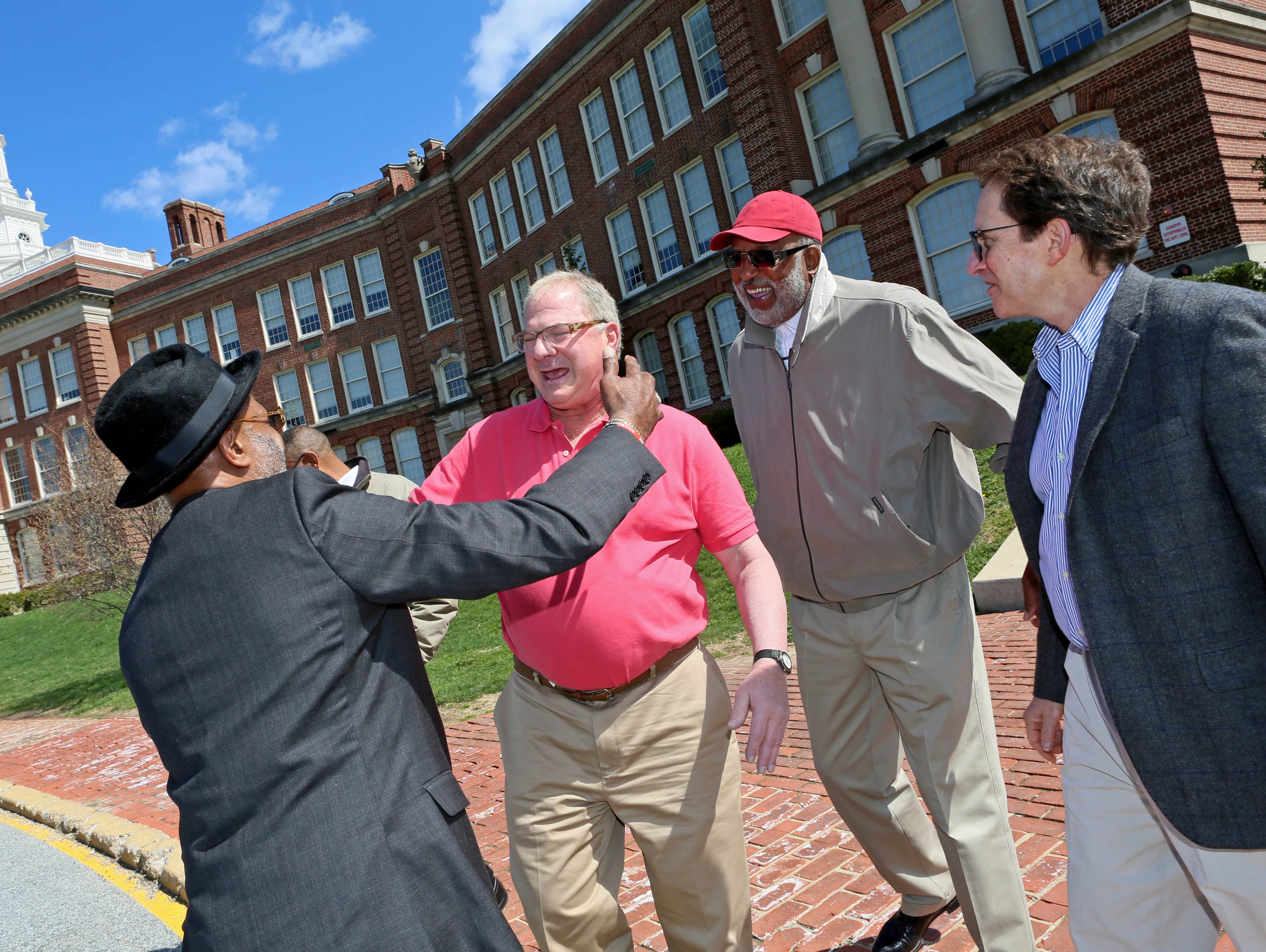 Former 1968 state championship basketball teammates Bobbie Dillard, Dennis Spivack, Ron Smith and Andy Berger, reunited in front of the old P.S. du Pont High School where they all once played.
