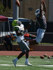 McMurry safety Jordan Washington breaks up a pass intended for Belhaven receiver LaMarcus Caradine during the War Hawks' homecoming win. Although McMurry's athletics dropped from Division II to Division III, Washington stuck with the program.