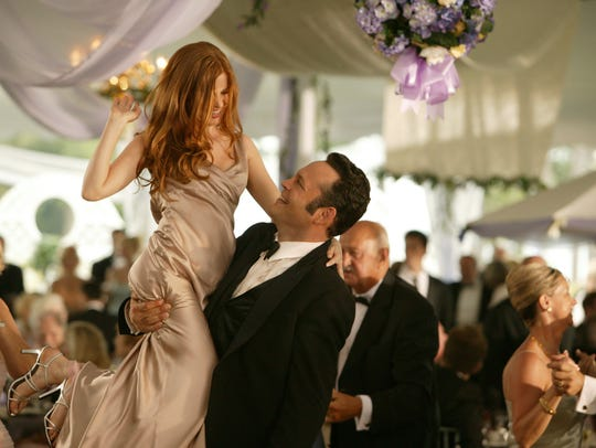 "Isla Fisher, left, and Vince Vaughn in ""Wedding Crashers."""