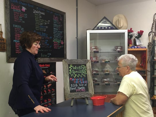 Karla Gambill sells meat at C&K Meats in Forsyth.
