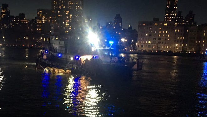 This image made from video provided by the New York City Police Department shows the scene of a helicopter crash in the East River in New York on Sunday.