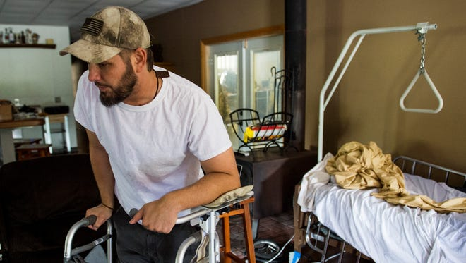 Musician Drew Landry speaks about his current situation during an interview in Youngsville, La., Thursday, May 14, 2015. Landry was badly injured in a head-on vehicle collision in April.