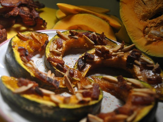 These kabocha wedges are topped with brown sugar, toasted almonds and bacon bits.