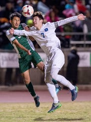 Redwood's Logan Corley, right, battles with a Reedley