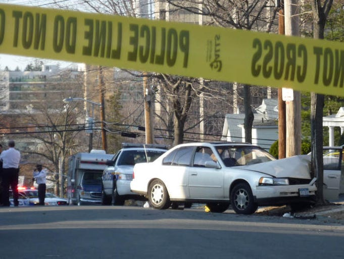 White Plains police investigate the aftermath of a shooting in front of of 44 Dekalb Ave in White Plains, March, 18, 2011.