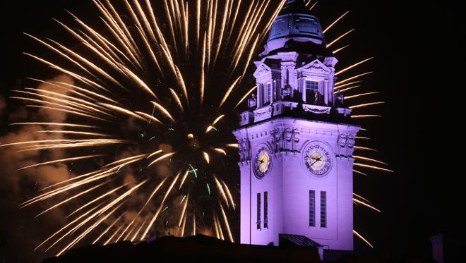 Fireworks burst behind the City Hall clock tower as the City of Yonkers held their 4th of July celebration & fireworks on the waterfront, July 4, 2015. The event sponsored by Empire City Casino, featured three music stages, food vendors, Colonial reenactments, arts and crafts and fireworks over the Hudson River.