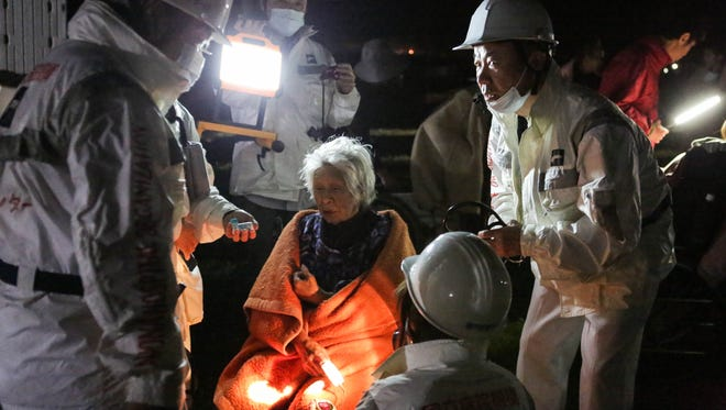 Rescue workers take care of an elderly woman  after a 7.3 magnitude earthquake struck around Mashiki, Kumamoto, Japan. The earthquake hit Kumamoto prefecture for a second time following another 6.4 earthquake on April 14, 2016 that killed nine people.