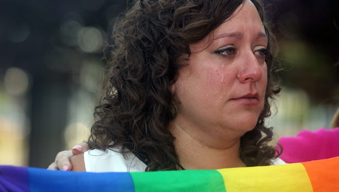 Brooke Malloy of Valley Cottage, the incoming executive director of the Rockland County Pride Center, cries as the names of the 49 victims of the Orlando shooting are read during a vigil in front of the Rockland County office building in New City June 15, 2016. Elected officials, religious leaders, and others spoke at the ceremony to remember those killed and injured in the Orlando nightclub shooting.