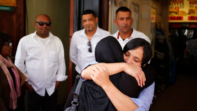 Celeste Nurse, right facing, the biological mother of the South African born kidnapped child Zephany Nurse, embraces a family member after court proceedings in Cape Town, South Africa, Monday, Aug. 15, 2016.