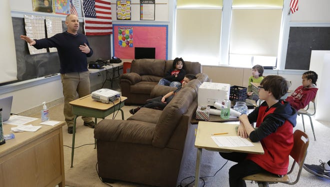 John Sikora, a teacher in the Whatever It Takes program, talks to the students during class time March 14, 2017. About a dozen students are enrolled in the Oshkosh Area School District program, which is for students with emotional and behavioral issues.
