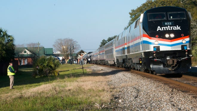 An Amtrak train stops at the Heinberg Street station in Pensacola Friday morning Feb. 19, 2016. The Pensacola stop is part of the Southern Rail Commission's Gulf Coast Passenger Rail Inspection trip.