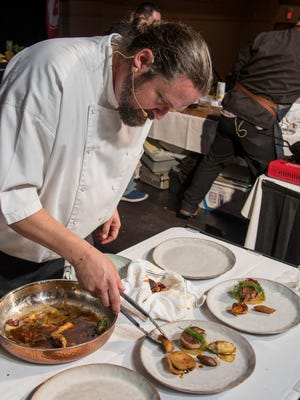 Chef Jason Helfer of San Angelo's Peasant Village restaurant competes in the San Angelo Symphony's 2017 Culinary Challenge.