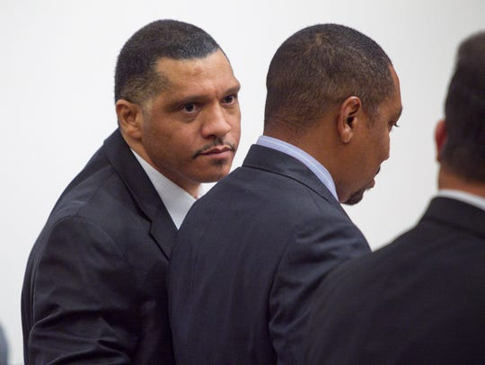 Mark Goudeau, left, talks with his attorneys June 6,