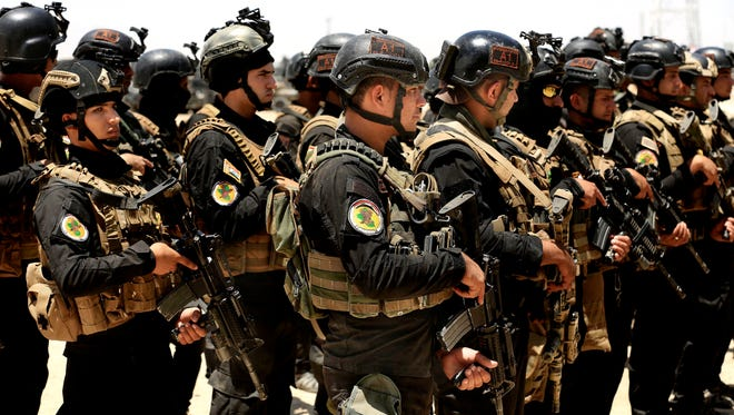 Iraq's elite counter-terrorism forces gather ahead of an operation to re-take the Islamic State-held City of Fallujah, outside Fallujah, Iraq, May 29, 2016.
