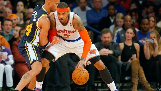 New York Knicks small forward Carmelo Anthony (7) works the baseline against Utah Jazz small forward Richard Jefferson (24).