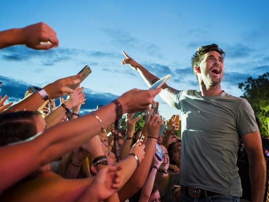 Jake Owen walks into he crowd at the Big Barrel Country Music Festival last year. He will headline a Delaware State Fair kick-off concert July 20.
