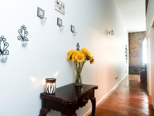 Flowers lend a bright accent to the entry way of Deanna Sanidad's loft apartment at Flyingfish Lofts in downtown Marion.
