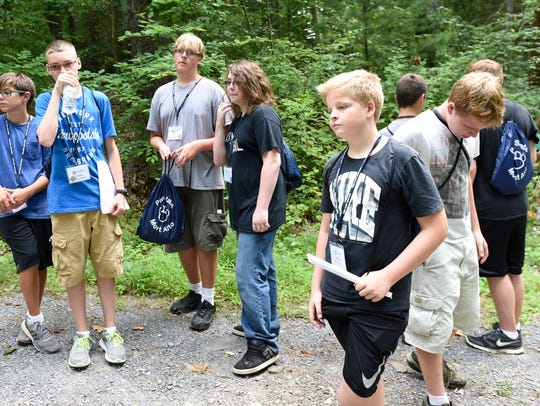 Students attend a class on geocaching as they walk