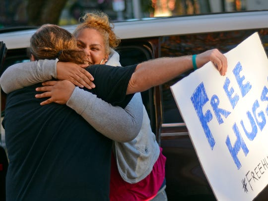 Mircely Cruz of York jumps out of her car for a hug