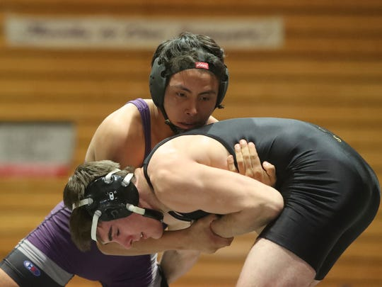 Shasta High's Luis Martinez defeats Enterprise's Aidan Gall at 138 pounds during their dual meet Wednesday at Shasta High School.