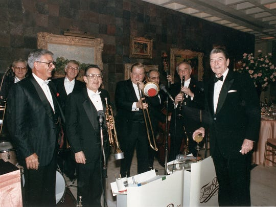 Former President Ronald Reagan stands alongside an orchestra playing at the Annenberg Estate in Rancho Mirage.