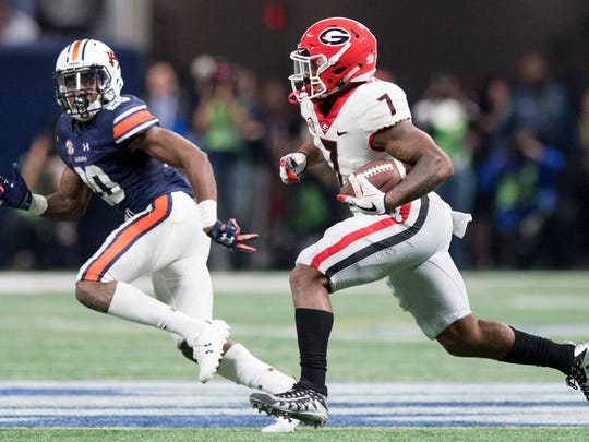 Georgia running back D'Andre Swift (7) gets by Auburn defensive back Jeremiah Dinson (20) for a long touchdown in second half action of the SEC Championship Game at Mercedes-Benz Stadium in Atlanta, Ga. on Saturday December 2, 2017. (Mickey Welsh / Montgomery Advertiser)