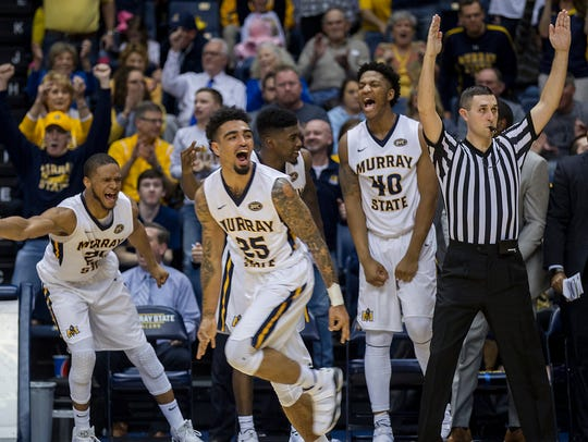 Murray State's Byron Hawkins (25) gestures after scoring