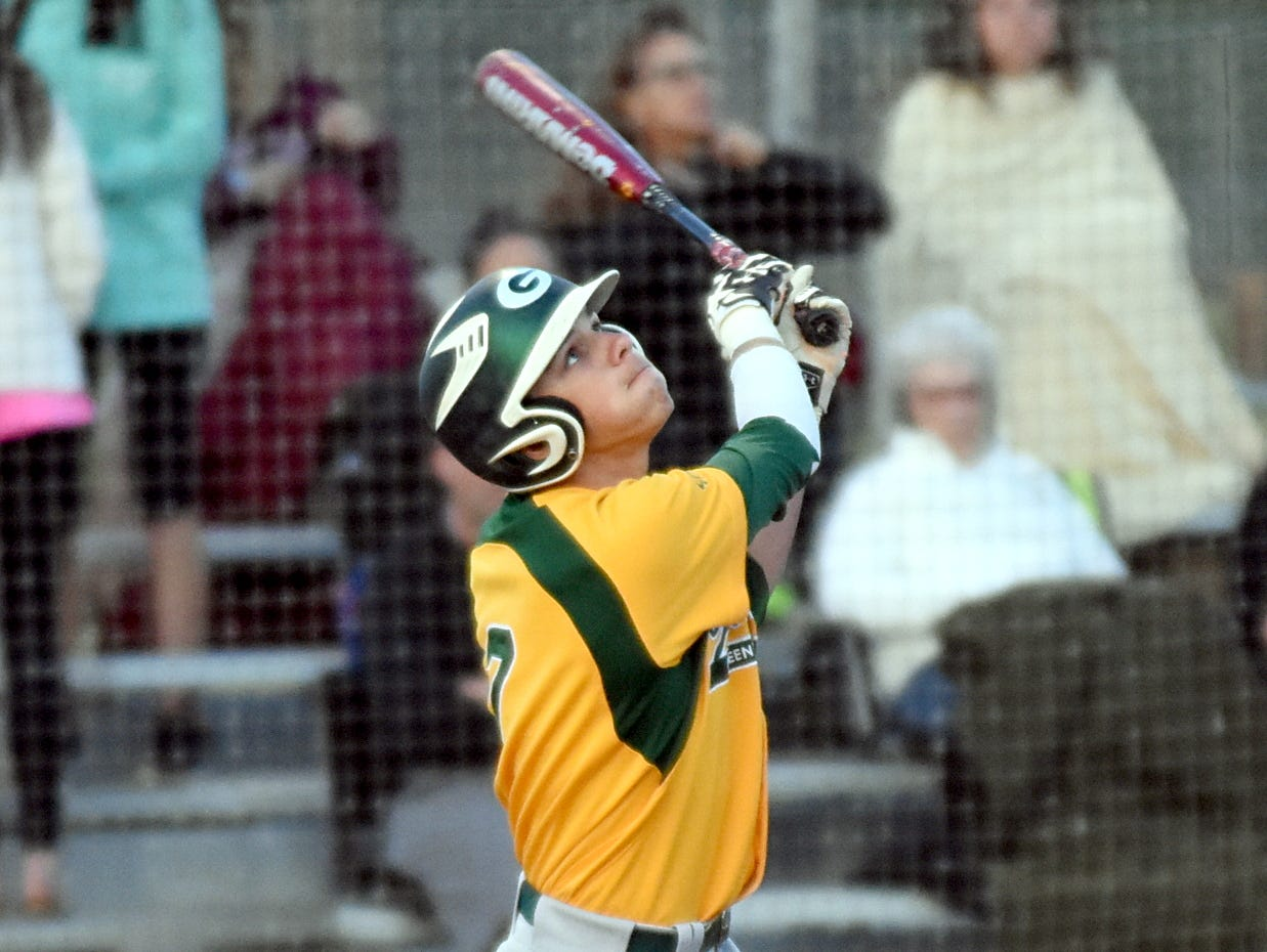 Gallatin High junior Andy Denning follows through after making contact with a first-inning pitch.