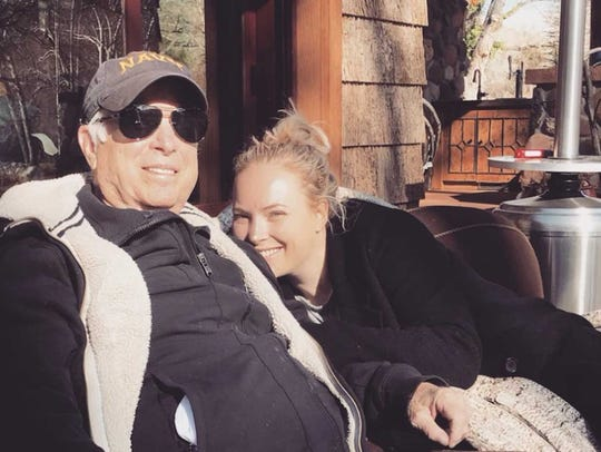 Sen. John McCain and his daughter Meghan relax outside