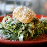 The twice-cooked egg at Chartreuse is poached, coated in panko breadcrumbs and deep fried. It comes served on a bed of frisee, pea tendrils and roasted Brussels sprouts and is topped with salty cheese and warm shallot vinaigrette.  Chartreuse Kitchen & Cocktails is located  inside the Park Shelton in Detroit.