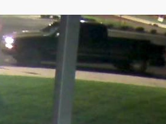 Pictured is the Silverado that KPD believes the men loaded the candle stand into.