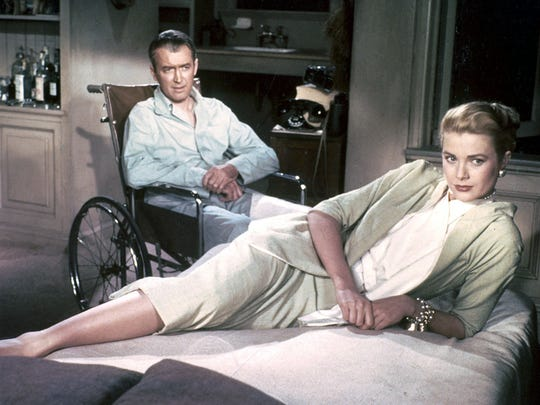 """Jeff (James Stewart) pulls his girlfriend Lisa (Grace Kelly) into his investigation when he comes to suspect a neighbor of murder in Alfred Hitchcock's """"Rear Window."""""""