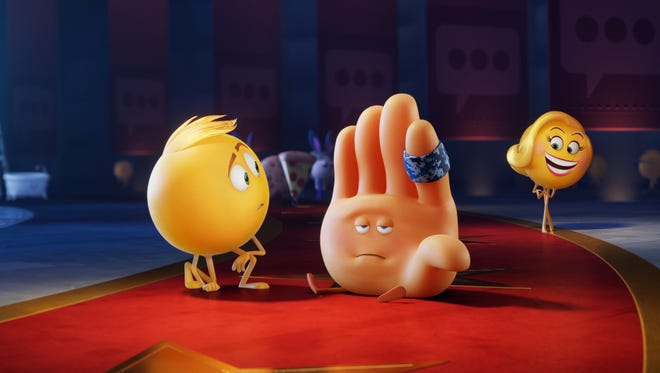 """Gene (voiced by T.J.Miller), Hi-5 (James Corden) and Smiler (Maya Rudolph) sort things out in """"The Emoji Movie."""""""