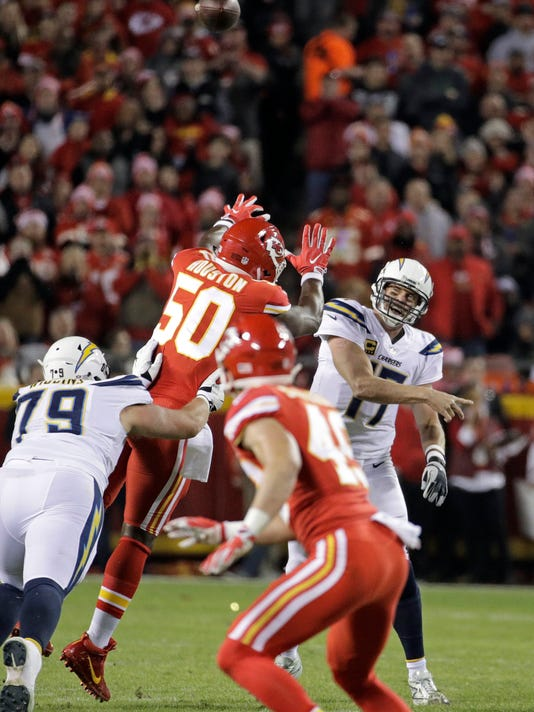 Los Angeles Chargers quarterback Philip Rivers (17) throws under pressure from Kansas City Chiefs linebacker Justin Houston (50) during the first half of an NFL football game in Kansas City, Mo., Saturday, Dec. 16, 2017. (AP Photo/Charlie Riedel)
