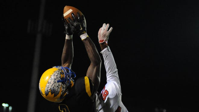 Wicomico's Josh Nicolas goes up for a big catch against Bennett High School on Friday, Nov. 6.