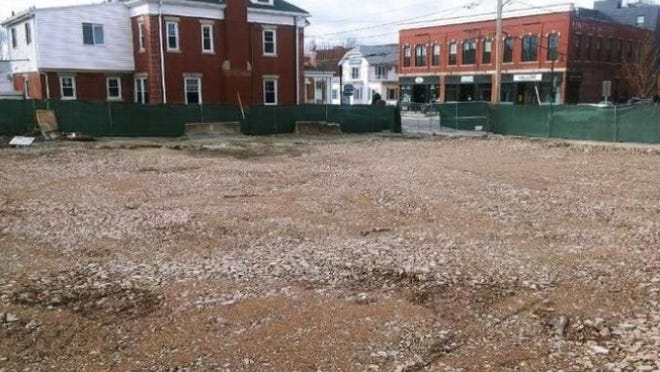 This is the site of a fire last July that destroyed several businesses in downtown Natick.