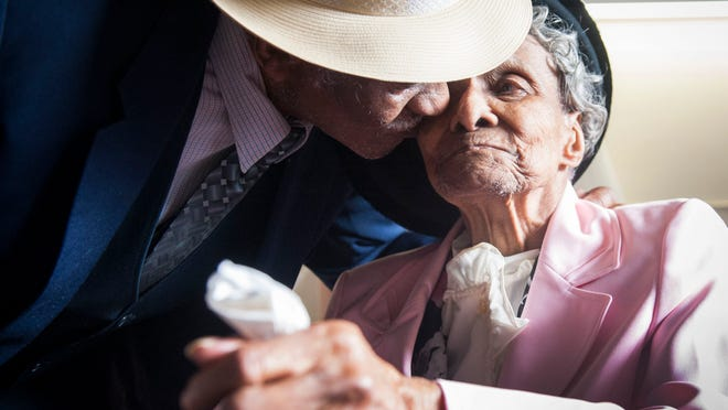 William, 97, and Willie Mae Fullwood, 100, both of Mount Laurel have been married for 75 years. They have 8 children together and currently stay in the same room at the Mount Laurel Center. They are celebrating turning 98 and 101 two days apart in February, January 25, 2015 in Mount Laurel. William kisses his wife on the cheek.