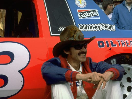 In this February 1981 photo, Richard Petty sits by his car at a NASCAR auto race. If you ain't cheatin', you ain't tryin'. The credit for that old saying generally goes to NASCAR legend Petty, though it just as easily could've come from Tom Brady, Gaylord Perry or pretty much any of the millions who have thrown, pitched or hit a ball since people started playing sports.
