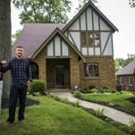 Sam Walston in front of his newly purchased home in Kennedy Heights. According to a recent study, millennials are the largest group of recent home buyers.