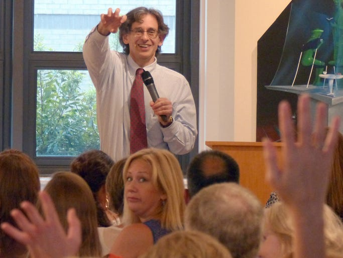 Author Alfie Kohn asks for a show of hands during his talk at the Artel Gallery in downtown Pensacola Friday night.  Kohn is noted for his books on education, parenting and human behavior.  The lecture was sponsored by the Creative Learning Academy and the University of West Florida.