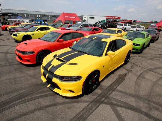 A fleet of 2017 Dodge Challenger and Charger SRT sports cars at the race track during setup on Thursday, August 10, 2017 for the Dodge Roadkill Nights powered by Dodge on the M1 Concourse in Pontiac.